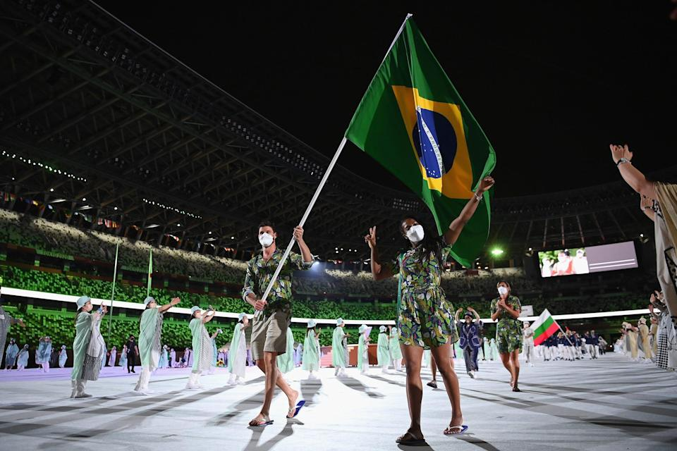 Flag bearers Ketleyn Quadros and Bruno Mossa Rezende of Team Brazil lead their team out during the opening ceremony.