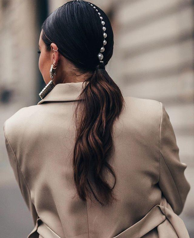 """<p>Not gonna lie—low ponytails can be, well, a <em>little</em> boring. One way to fix a meh look fast is with an edgy accessory, like <a href=""""https://www.leletny.com/shop/pearl-spine-comb"""" rel=""""nofollow noopener"""" target=""""_blank"""" data-ylk=""""slk:this string of pearl studs"""" class=""""link rapid-noclick-resp""""><strong>this string of pearl studs</strong></a>, down your center part.</p><p><a href=""""https://www.instagram.com/p/BusDeoxA9TC/"""" rel=""""nofollow noopener"""" target=""""_blank"""" data-ylk=""""slk:See the original post on Instagram"""" class=""""link rapid-noclick-resp"""">See the original post on Instagram</a></p>"""
