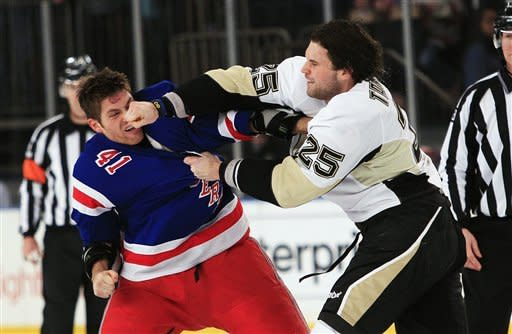 Pittsburgh Penguins' Eric Tangradi (25) punches New York Rangers' Stu Bickel (41) during the first period of an NHL hockey game on Thursday, Jan. 19, 2012, in New York. (AP Photo/Frank Franklin II)