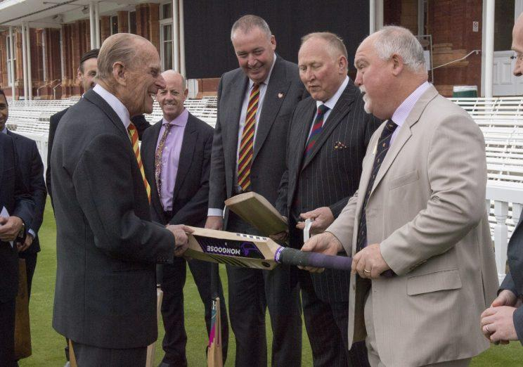 The Duke of Edinburgh (left) is shown a number of bats by Mike Gatting (right), during a visit to Lord's cricket ground