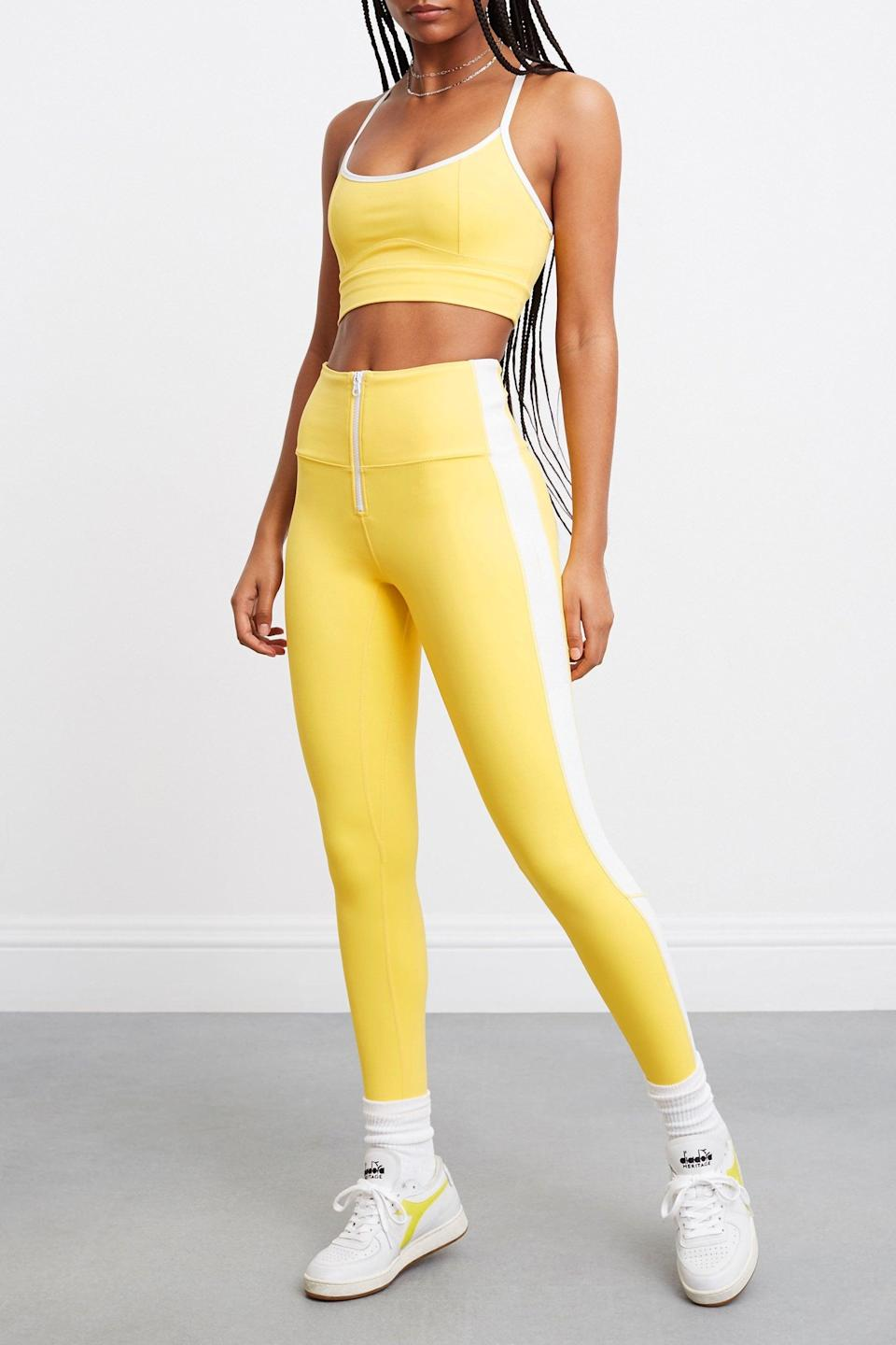 <p>Bring the sunshine to your workout in this <span>Bandier x Solid &amp; Striped Soleil Zip Front Legging</span> ($79, originally $118) and the matching <span>Soleil Strappy Bra</span> ($54, originally $78).</p>
