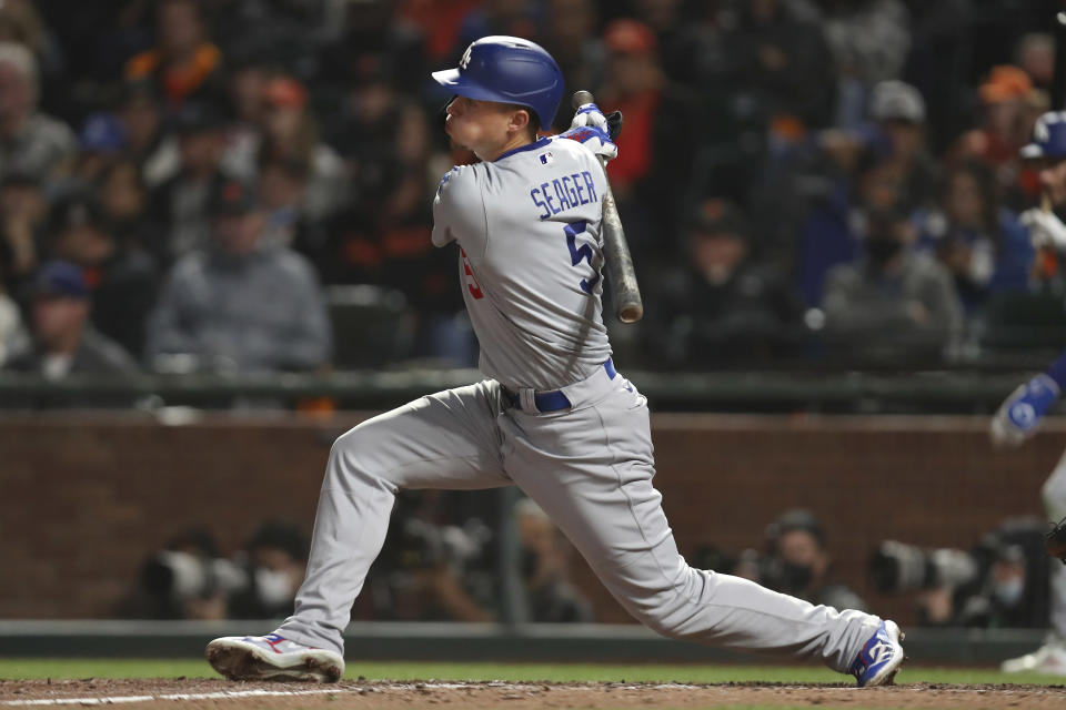 Los Angeles Dodgers' Corey Seager hits an RBI-single against the San Francisco Giants during the eighth inning of Game 2 of a baseball National League Division Series Saturday, Oct. 9, 2021, in San Francisco. (AP Photo/Jed Jacobsohn)