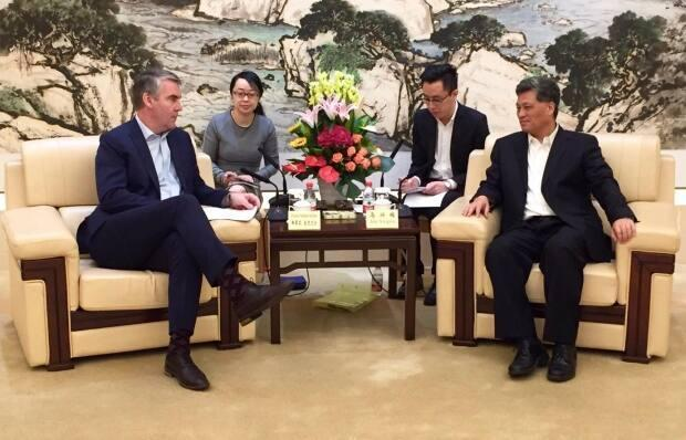 Then premier of Nova Scotia, Stephen McNeil, meets with Guangdong province Gov. Ma Xingrui during a 2019 trip to China.