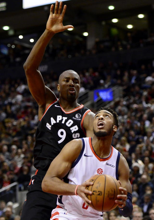 Washington Wizards guard Troy Brown Jr. (6) looks for a shot as Toronto Raptors forward Serge Ibaka (9) defends during the second half of an NBA basketball game Friday, Dec. 20, 2019, in Toronto. (Frank Gunn/The Canadian Press via AP)