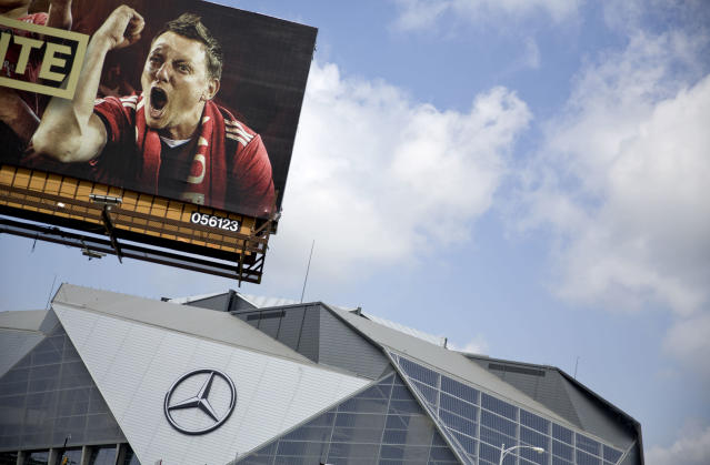 A billboard for Atlanta's MLS soccer team stands next to Mercedes-Benz Stadium where the team plays in Atlanta, Wednesday, June 13, 2018. The 2026 World Cup will return to the U.S. for the first time since 1994. Atlanta's new Mercedes-Benz Stadium was shown prominently in the video used in the North American pitch for the bid. (AP Photo/David Goldman)