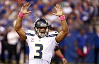 Seattle Seahawks quarterback Russell Wilson celebrates a touchdown pass to wide receiver Darrius Heyward-Bey during the first half of an NFL football game against the Indianapolis Colts in Indianapolis, Sunday, Oct. 6, 2013. (AP Photo/Brent R. Smith)
