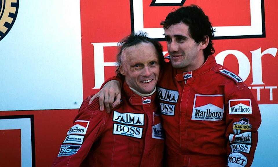 McLaren teammates Niki Lauda and Alain Prost on the podium after the former won the 1984 Championship by a mere half a point.