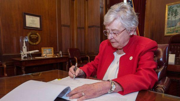 PHOTO: Alabama Governor Kay Ivey signs the Alabama Human Life Protection Act, after both houses of the Alabama Legislature passed HB314, May 15, 2019. (State of Alabama Office of the Governor )