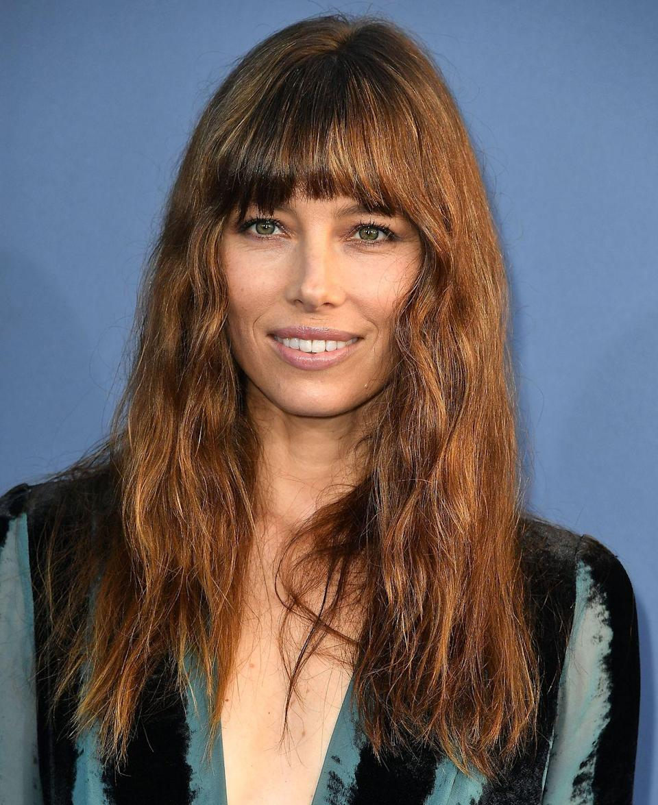 """<p>Jessica Biel's shaggy style is a more fun, modern-feeling reimagining of her usual sleek hairstyle. </p><p>Keep a full fringe sweat free in the heat with a spritz of dry shampoo.</p><p><strong>ELLE Loves...</strong>Philip Kingsley One More Day Dry Shampoo - £17 <a class=""""link rapid-noclick-resp"""" href=""""https://go.redirectingat.com?id=127X1599956&url=https%3A%2F%2Fwww.net-a-porter.com%2Fgb%2Fen%2Fproduct%2F566551%2FPHILIP_KINGSLEY%2Fone-more-day-dry-shampoo-200ml&sref=https%3A%2F%2Fwww.elle.com%2Fuk%2Fbeauty%2Fhair%2Fg14897%2Ffringe-benefits%2F"""" rel=""""nofollow noopener"""" target=""""_blank"""" data-ylk=""""slk:SHOP NOW"""">SHOP NOW</a></p>"""