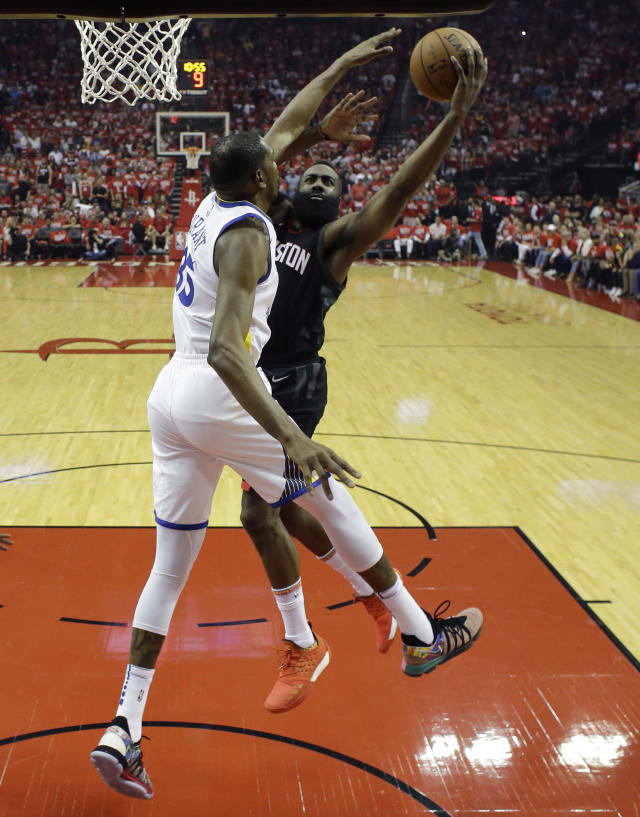 Houston Rockets guard James Harden, right, drives to the basket against Golden State Warriors forward Kevin Durant (35) in the first half during Game 1 of the NBA Western Conference Finals, Monday, May 14, 2018, in Houston. (AP Photo/David J. Phillip)