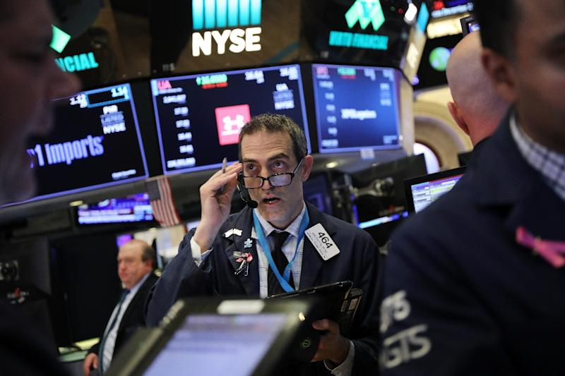 Wall Street was cheered by Fed chief Jerome Powell's comments, bouncing 3% before midday and recovering much of Thursday's lost ground (AFP Photo/SPENCER PLATT)