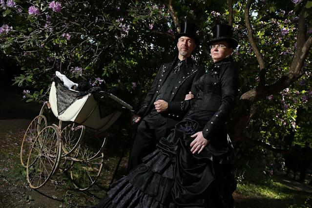 <p>A couple dressed in Victorian-inspired outfits and wheeling a baby pram attend the Victorian picnic on the first day of the annual Wave-Gotik-Treffen (WGT) Goth music festival on June 2, 2017 in Leipzig, Germany. (Sean Gallup/Getty Images) </p>