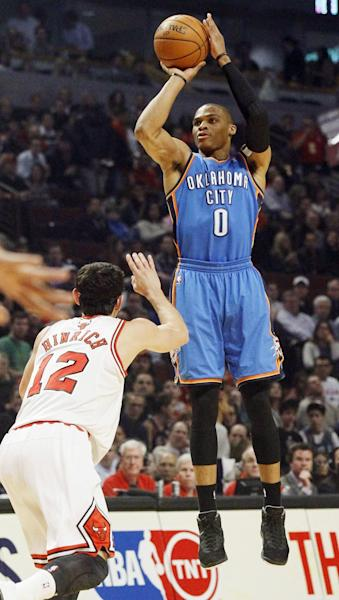 Oklahoma City Thunder guard Russell Westbrook (0) shoots over Chicago Bulls guard Kirk Hinrich (12) during the first half of an NBA basketball game, Thursday, Nov. 8, 2012, in Chicago. (AP Photo/Charles Rex Arbogast)