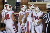 Wisconsin fullback Mason Stokke (34) celebrates his touchdown with teammates in the first quarter of an NCAA college football game against Michigan in Ann Arbor, Mich., Saturday, Nov. 14, 2020. (AP Photo/Tony Ding)