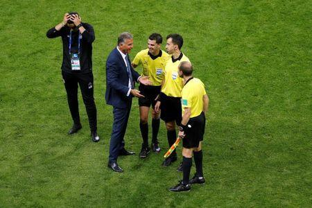 Soccer Football - World Cup - Group B - Iran vs Spain - Kazan Arena, Kazan, Russia - June 20, 2018 Iran coach Carlos Queiroz speaks with referee Andres Cunha and match officials after the match REUTERS/John Sibley