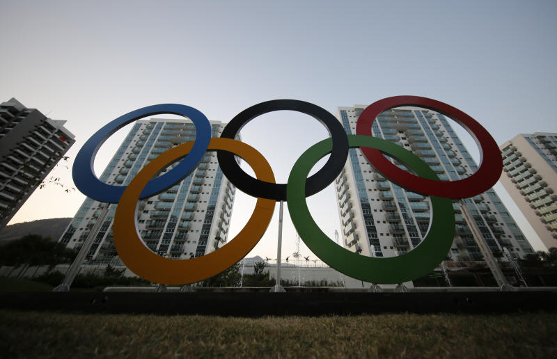 In this July 23, 2016, file photo, a representation of the Olympic rings are displayed in the Olympic Village in Rio de Janeiro, Brazil. The U.S. Olympic and Paralympic Committee will add athletes to its board and enhance its oversight of individual sports organizations. It's part of a package of reforms stemming from the Larry Nassar sex-abuse scandal. The reforms were approved Thursday, Nov. 8, 2019 and go into effect in January. (AP Photo/Leo Correa, File)