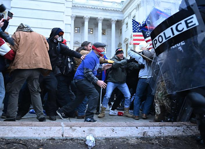 Trump supporters clash with police and security forces as they storm the U.S. Capitol on Jan. 6. (Photo: BRENDAN SMIALOWSKI/AFP via Getty Images)