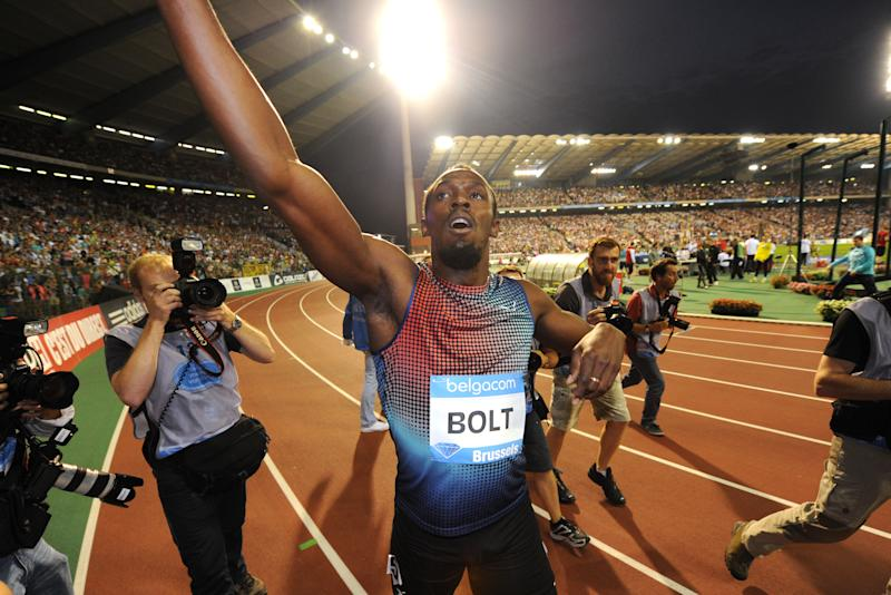 Usain Bolt from Jamaica reacts after he won the men's 100 meters at the Diamond League Memorial Van Damme athletics event, at Brussels' King Baudouin stadium, on Friday, Sept. 6, 2013. (AP Photo/Geert Vanden Wijngaert)