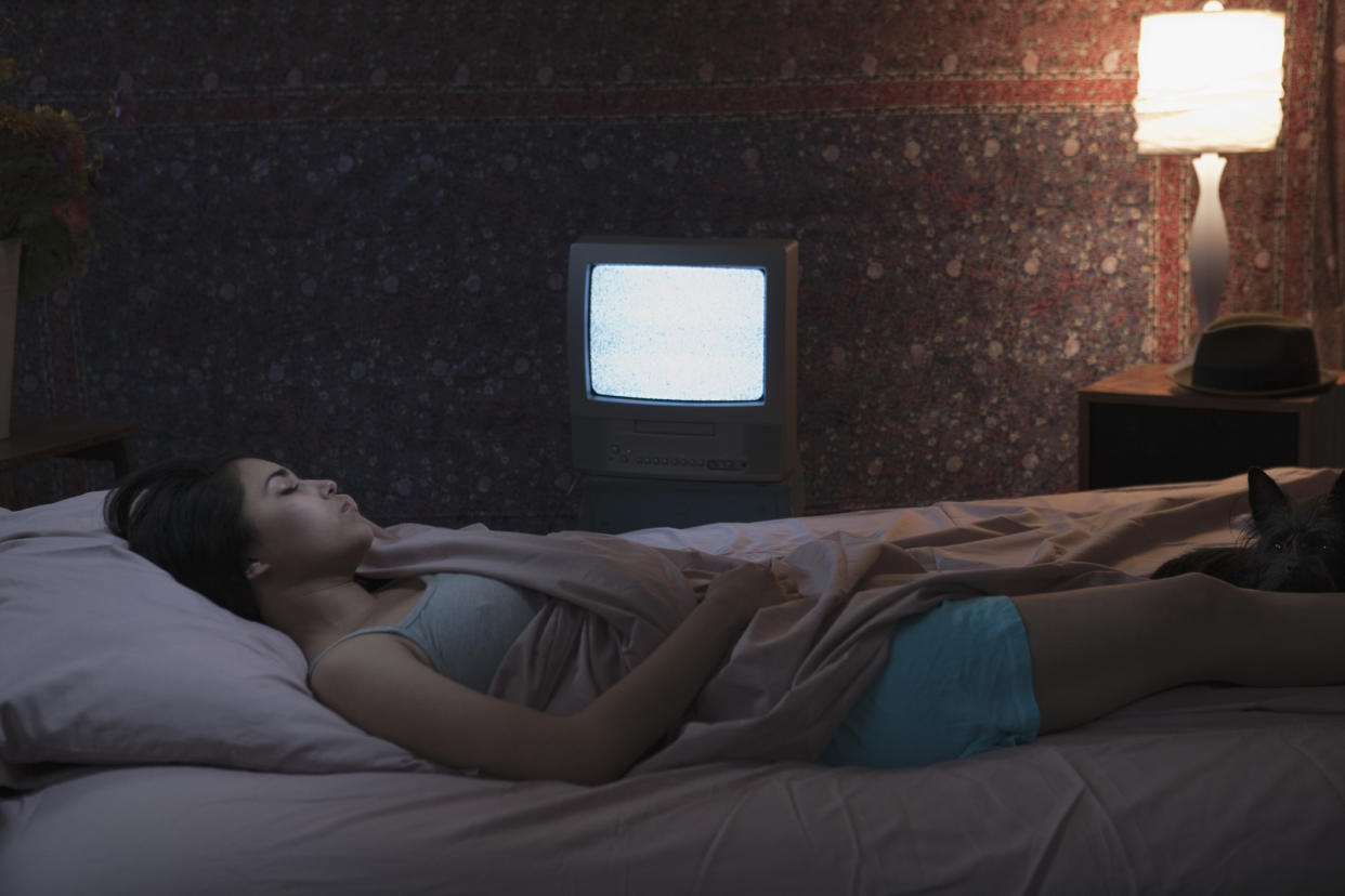 A new study has linked sleeping with the light or TV on and weight gain [Photo: Getty]
