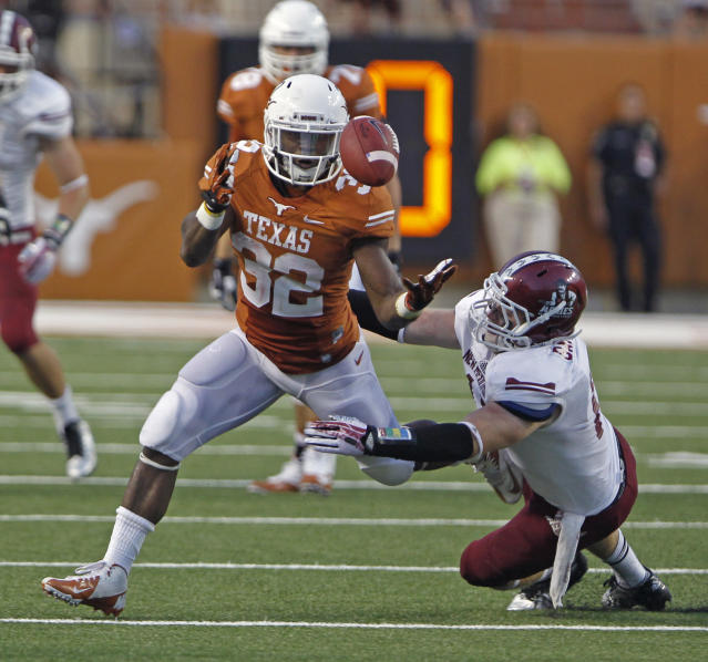 Texas running back Johnathan Gray (32) bobbles a pass before his catch of a David Ash pass while defended by New Mexico State linebacker Clint Barnard during the second quarter of an NCAA college football game Saturday Aug. 31, 2013, in Austin, Texas. (AP Photo/Michael Thomas)
