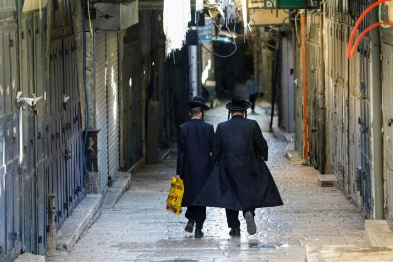 Lockdowns and restrictions on gatherings aimed at halting the virus' spread in Israel have shaken the rhythm of life for ultra-Orthodox Jews, pushing them to integrate in the world outside