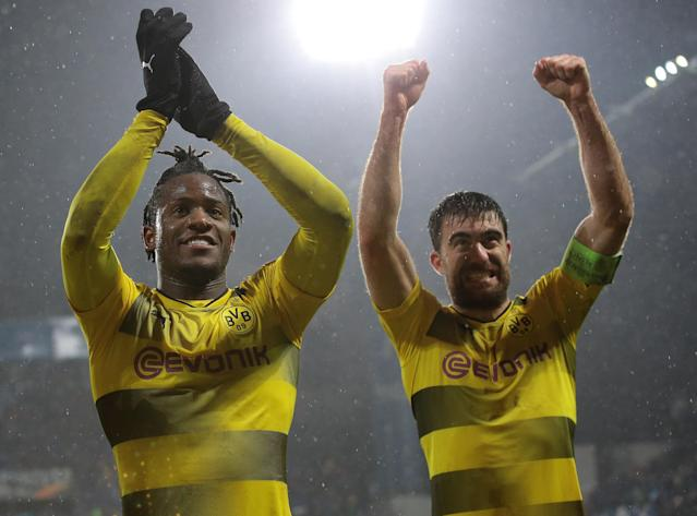 "<a class=""link rapid-noclick-resp"" href=""/soccer/teams/borussia-dortmund/"" data-ylk=""slk:Borussia Dortmund"">Borussia Dortmund</a>'s Michy Batshuayi and Sokratis Papastathopoulos celebrate Dortmund's progression to the Europa League round of 16. (Getty)"
