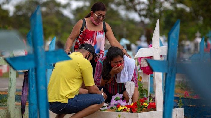 People visit a cemetery in Manaus, Amazonas State, Brazil, on 9 May