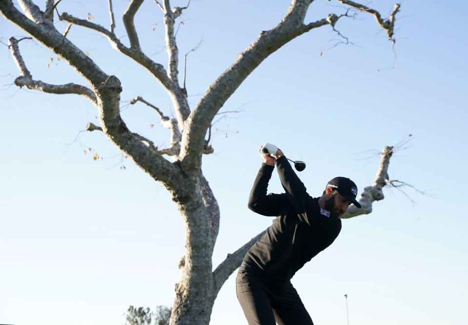 Dustin Johnson tees off on the third hole during the Genesis Invitational pro-am golf event at Riviera Country Club, Wednesday, Feb. 17, 2021, in the Pacific Palisades area of Los Angeles. (AP Photo/Ryan Kang)