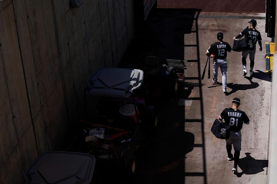 Vaughn and White Sox players walk to the field before a spring training game.