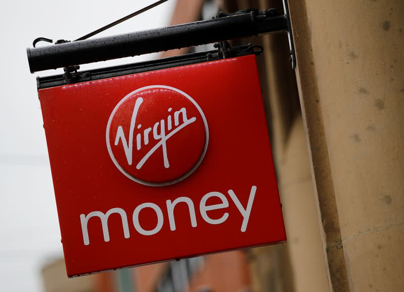 FILE PHOTO: Signage is seen outside a branch of Virgin Money in Manchester