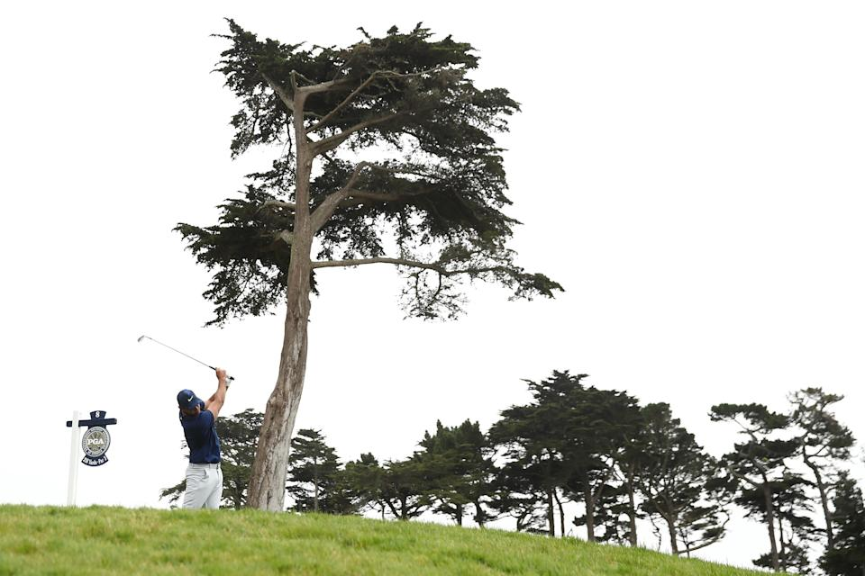 Brooks Koepka tries to keep it in play on a windy day at TPC Harding Park. (Photo by Ezra Shaw/Getty Images)