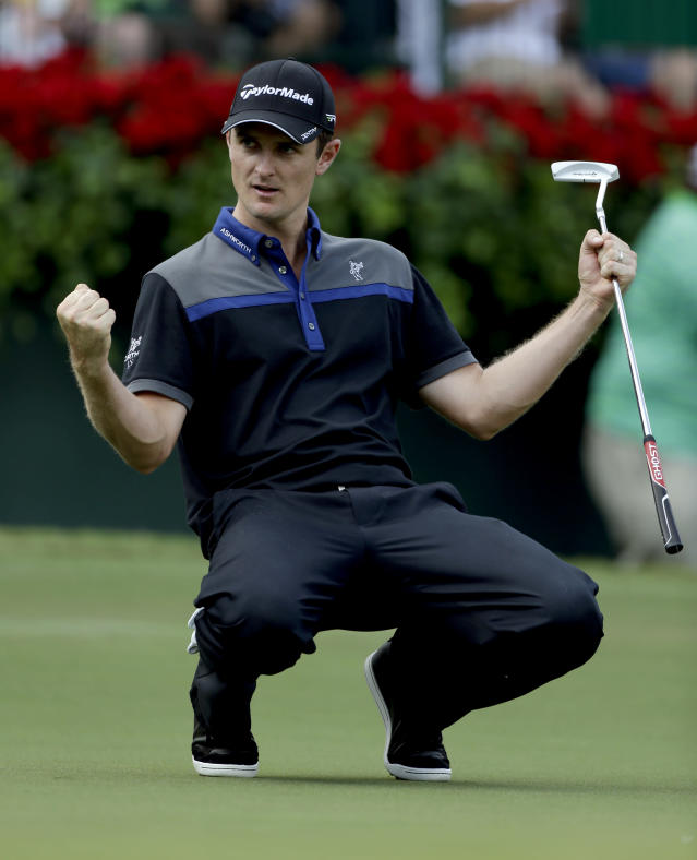 Justin Rose, of England, reacts after sinking his putt on the 18th hole during the first round of the Tour Championship golf tournament Thursday, Sept. 20, 2012, in Atlanta. (AP Photo/David Goldman)