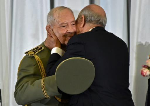 Algeria's newly inaugurated president embraces armed forces chief Lieutenant General Ahmed Gaid Salah, who has been the country's de facto strongman since veteran leader Abdelaziz Bouteflika was forced to step down in April