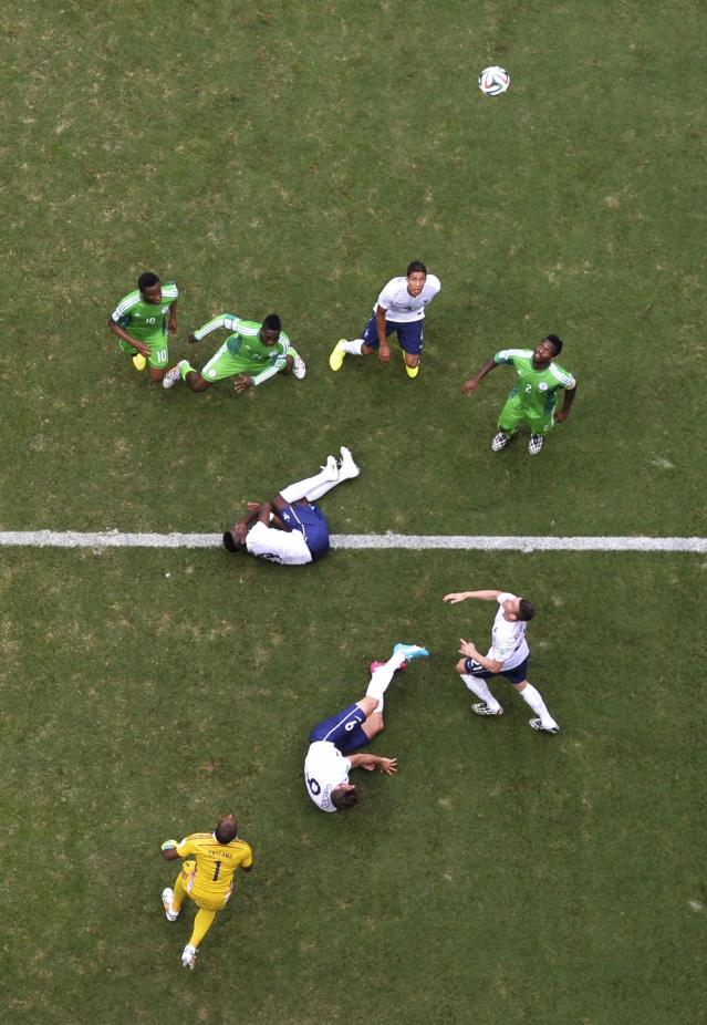 National soccer players of France and Nigeria fight for the ball near Nigeria's goal area as goalkeeper Vincent Enyeama (bottom) defends, during their 2014 World Cup round of 16 game at the Brasilia national stadium in Brasilia June 30, 2014. REUTERS/Francois Xavier Marit/Pool (BRAZIL - Tags: SOCCER SPORT WORLD CUP)