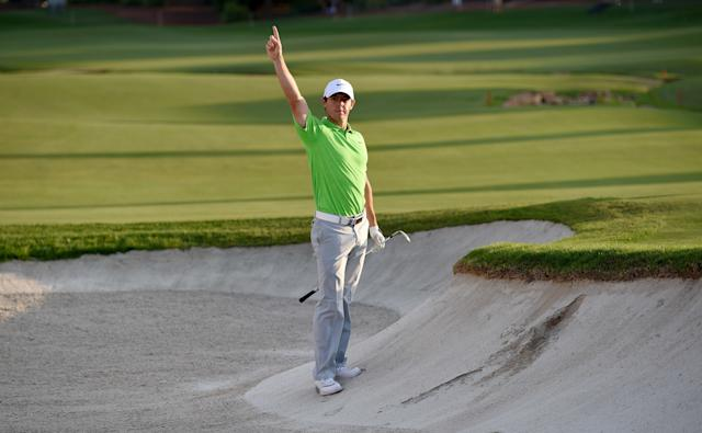 """<h1 class=""""title"""">DP World Tour Championship - Day One</h1> <div class=""""caption""""> DUBAI, UNITED ARAB EMIRATES - NOVEMBER 19: <a class=""""link rapid-noclick-resp"""" href=""""/pga/players/8016/"""" data-ylk=""""slk:Rory McIlroy"""">Rory McIlroy</a> of Northern Ireland celebrates after he holes out from the bunker on 18 green during the first round of the DP World Tour Championship at Jumeirah Golf Estates on November 19, 2015 in Dubai, United Arab Emirates. (Photo by Ross Kinnaird/Getty Images) </div> <cite class=""""credit"""">Ross Kinnaird</cite>"""
