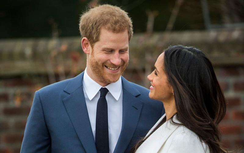 Prince Harry and his then fiance Megan Markle in the gardens of Kensington Palace - Paul Grover/The Telegraph
