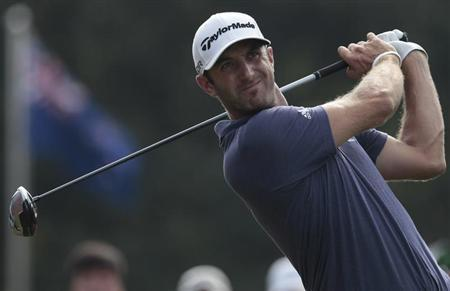 Dustin Johnson of the U.S. tees off on the 10th hole during the second round of the WGC-HSBC Champions golf tournament in Shanghai