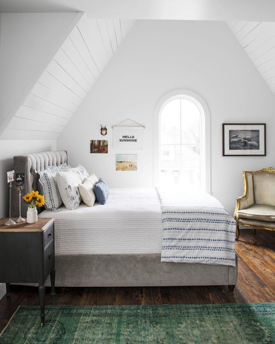 "<p>A bright green carpet underfoot makes all the difference in this cozy attic bedroom. </p><p><a class=""link rapid-noclick-resp"" href=""https://go.redirectingat.com?id=74968X1596630&url=https%3A%2F%2Fwww.wayfair.com%2Frugs%2Fpdp%2Fworld-menagerie-pascale-hand-woven-jute-greengraypink-area-rug-wrme2073.html&sref=https%3A%2F%2Fwww.goodhousekeeping.com%2Fhome%2Fdecorating-ideas%2Fg770%2Fdecor-ideas-master-bedroom%2F"" rel=""nofollow noopener"" target=""_blank"" data-ylk=""slk:SHOP RUGS"">SHOP RUGS</a></p><p><a href=""https://www.goodhousekeeping.com/home/renovation/g26132379/attic-ideas/"" rel=""nofollow noopener"" target=""_blank"" data-ylk=""slk:RELATED: 10 Dreamy Attic Ideas for Your Home's Coziest Space"" class=""link rapid-noclick-resp""><strong>RELATED:</strong> 10 Dreamy Attic Ideas for Your Home's Coziest Space</a></p>"