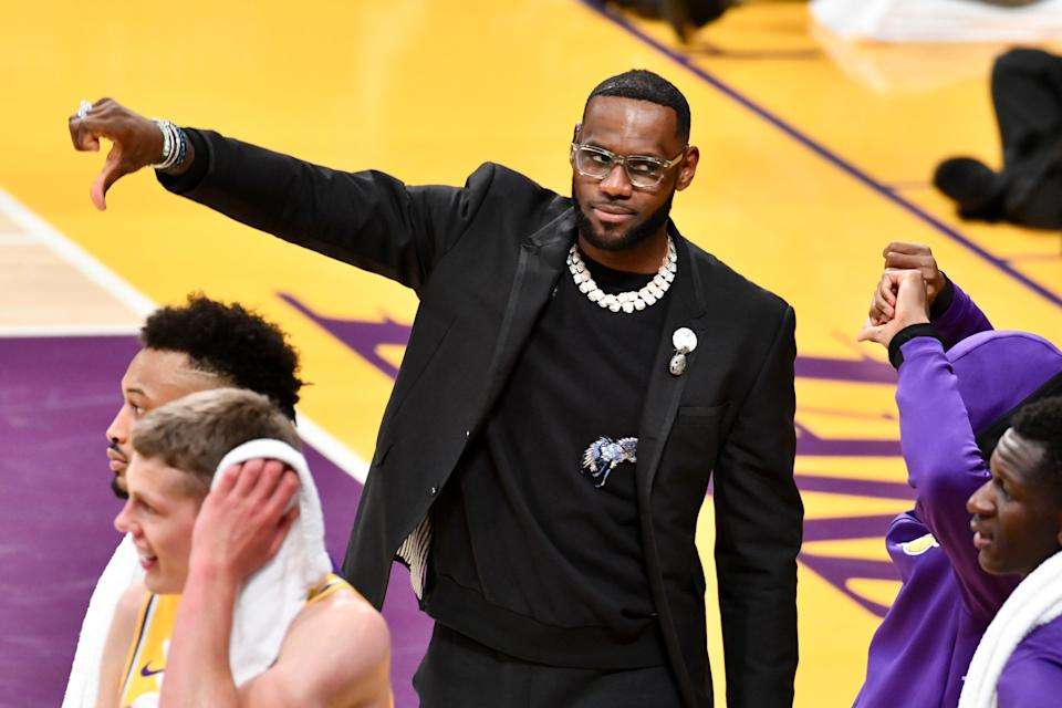 The world will have to wait for LeBron James' thoughts on Magic Johnson's resignation. (Getty)