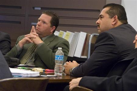 Former Fullerton police officers Jay Cicinelli (L), and Manuel Ramos (R) listen during the trial of Ramos and Cincinelli in Santa Ana, California January 7, 2014. REUTERS/Joshua Sudock/Pool