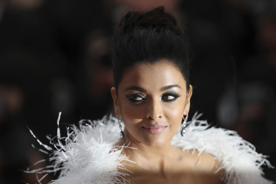 FILE- In this May 20, 2019 file photo, Aishwarya Rai Bachchan poses for photographers upon arrival at the premiere of the film 'La Belle Epoque' at the 72nd international film festival, Cannes, southern France. Bollywood superstar Amitabh Bachchan, his son and two other family members including Aishwarya Rai Bachchan have tested positive for the coronavirus in Mumbai, India's financial and entertainment capital, a government minister said Sunday. (AP Photo/Petros Giannakouris, File)