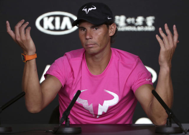 Spain's Rafael Nadal gestures during a press conference ahead of the Australian Open tennis championships in Melbourne, Australia, Saturday, Jan. 12, 2019. (AP Photo/Mark Schiefelbein)