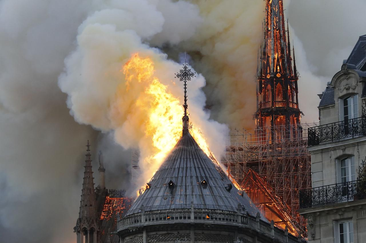 <p>A major fire broke out at the landmark Notre Dame Cathedral in central Paris sending flames and huge clouds of grey smoke billowing into the sky, the fire service said. The flames and smoke plumed from the spire and roof of the gothic cathedral, visited by millions of people a year, where renovations are currently underway. (Photo by FRANCOIS GUILLOT/AFP/Getty Images) </p>