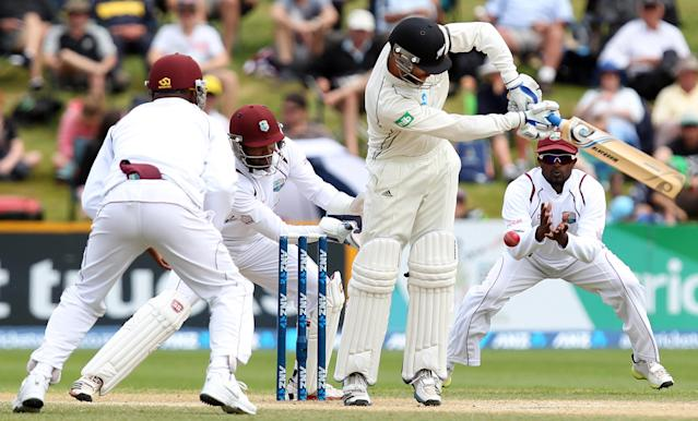 DUNEDIN, NEW ZEALAND - DECEMBER 07: Aaron Redmond of New Zealand hits the ball straight to Narsingh Deonarine to be caught out during day five of the first test match between New Zealand and the West Indies at University Oval on December 7, 2013 in Dunedin, New Zealand. (Photo by Rob Jefferies/Getty Images)