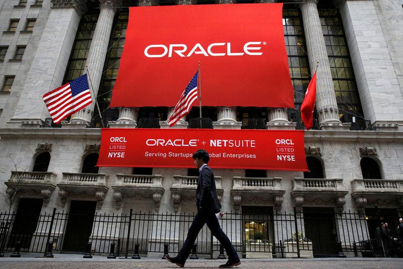 FILE PHOTO: An Oracle banner hangs outside the New York Stock Exchange (NYSE) in New York City