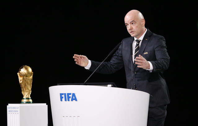 FIFA President Gianni Infantino speaks beside the World Cup trophy at the FIFA congress on the eve of the opener of the 2018 soccer World Cup in Moscow, Russia, Wednesday, June 13, 2018. The congress in Moscow is set to choose the host or hosts for the 2026 World Cup. (AP Photo/Alexander Zemlianichenko)