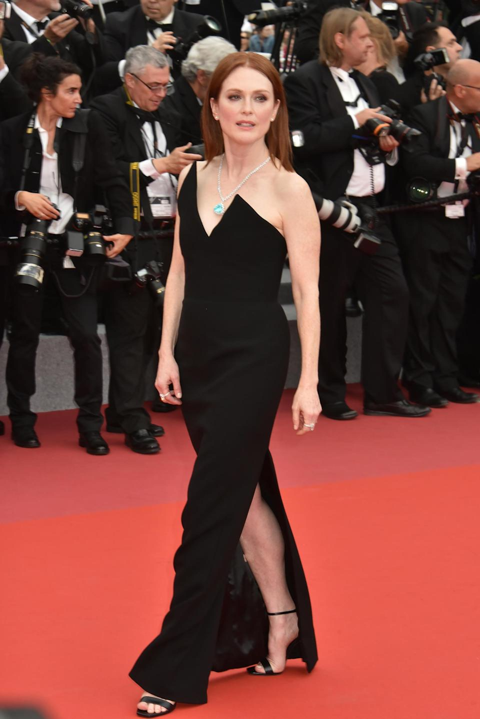 <p>Julianne looked flawless on the Cannes red carpet wearing a velvet Saint Laurent dress with a sculptured bodice and thigh split.<br><em>[Photo: Getty]</em> </p>