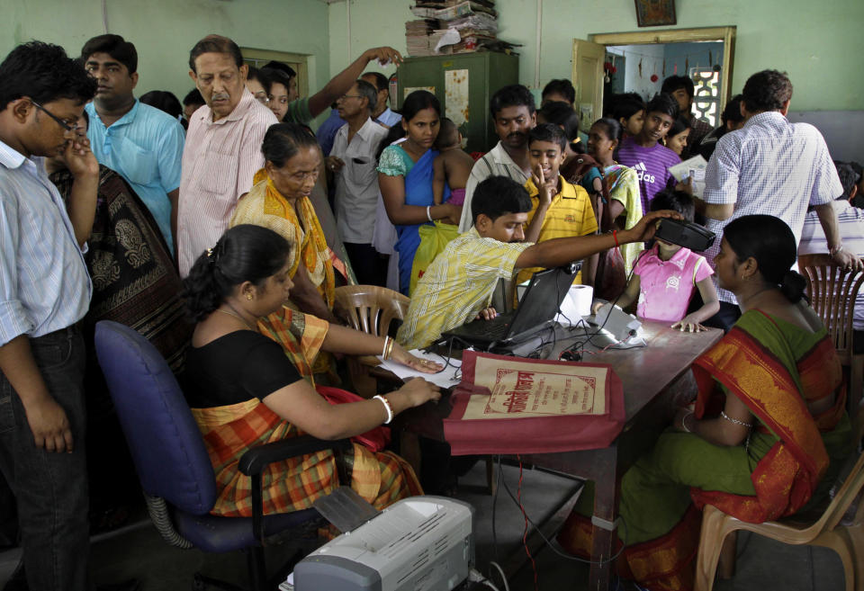 In this Wednesday, May 16, 2012, file photo, Indians crowd a room as they wait to enroll for Aadhar, India's unique identification project in Kolkata, India. A U.S.-based private cybersecurity company said Wednesday, Sept. 22, 2021, it has uncovered evidence that an Indian media conglomerate, a police department and the agency responsible for the country's national identification database have been hacked, likely by a state-sponsored Chinese group. (AP Photo/Bikas Das, File)