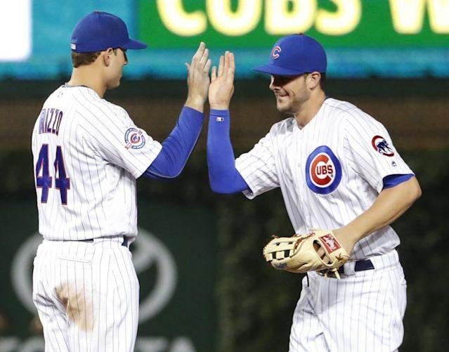Kris Bryant and Anthony Rizzo have plenty to high five about. (AP)