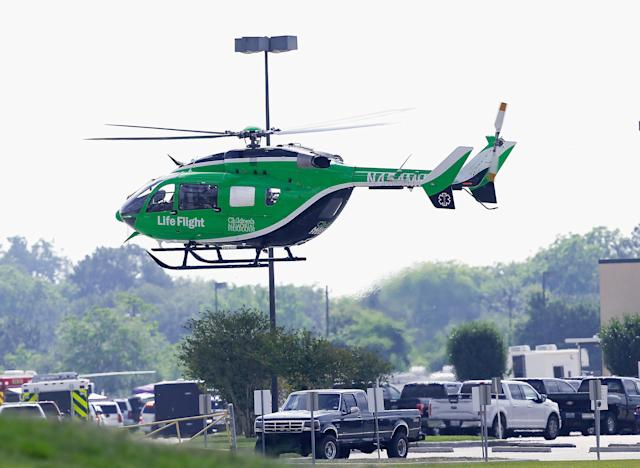<p>A Life Flight helicopter takes off from Santa Fe High School where a shooting took place on May 18, 2018 in Santa Fe, Texas. (Photo: Bob Levey/Getty Images) </p>